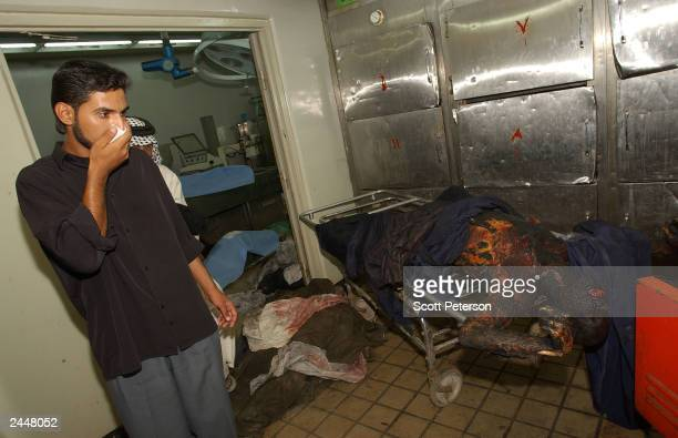 Iraqis visit the morgue of the Najaf Teaching Hospital to identify and claim the victims of the car bombing August 30 2003 in Najaf Iraq Over 100...