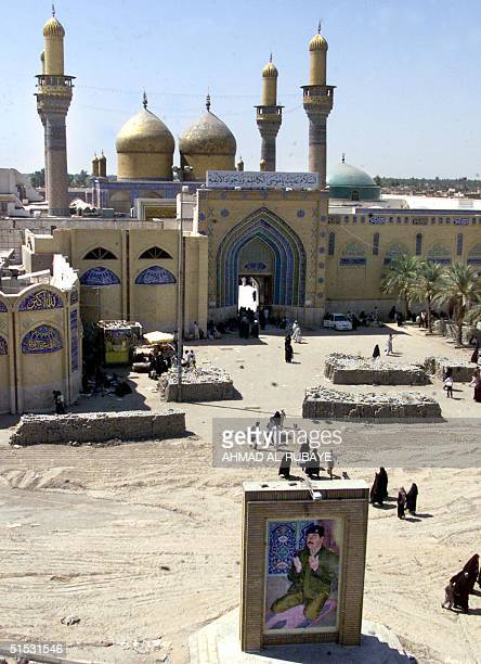 Iraqis visit the Shiite Muslim mosque of Imam alKazem in Baghdad's predominantly Shiite southern suburb of alKazimiya 12 September 2002 The United...