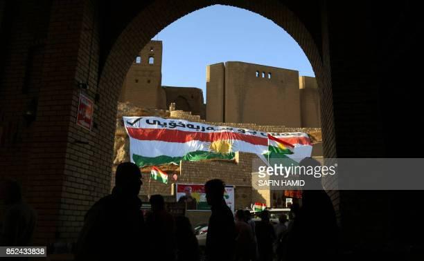 Iraqis walk in the square in the citadel in Arbil the capital of the autonomous Kurdish region of northern Iraq on September 23 2017 Iraqi Kurdish...