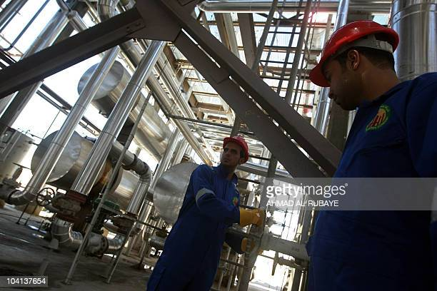 Iraqis work at the second refinery for crude oil in the AlDora refinery complex after its official opening ceremony in Baghdad on September 16 2010...