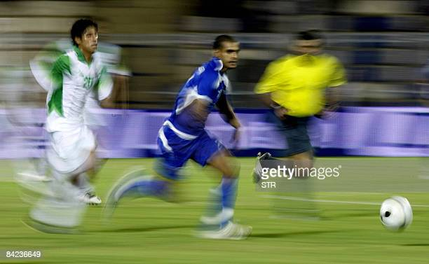 Iraqs Ahmed Abdali Vies With Kuwaits Bader AlMutawa During Their 19th Gulf Cup Football Match In