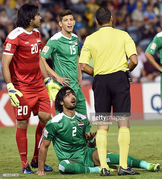 Iraq's Ahmed Ibrahim tries to appeal to referee Nawaf Shukralla of Bahrain as he gives a red card during the thirdplace playoff football match...