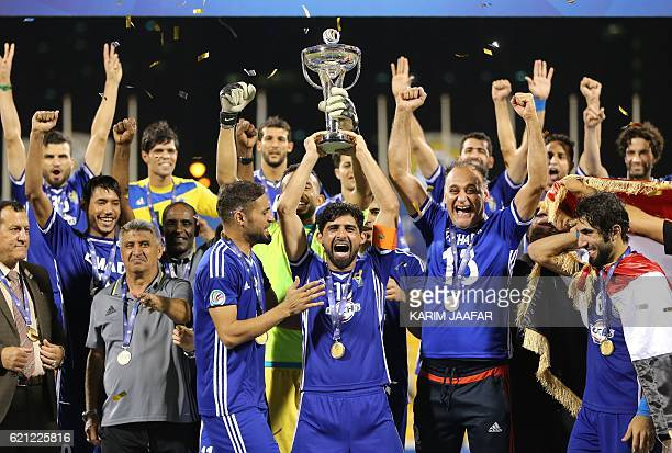 Iraq's Air Force Club players celebrate with the trophy after beating India's Bengaluru FC to win the AFC Asian Cup football final at the Qatar...
