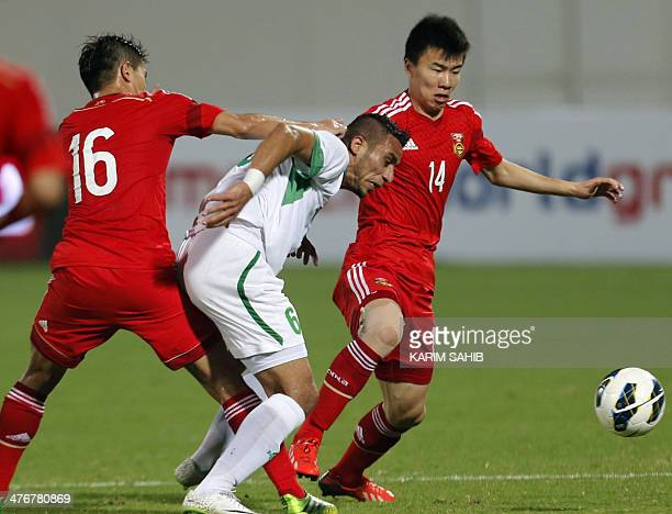 Iraq's Ali Adnan fights for the ball with Sun Ke of China during their qualification football match for the Asian Cup Australia 2015 China versus...