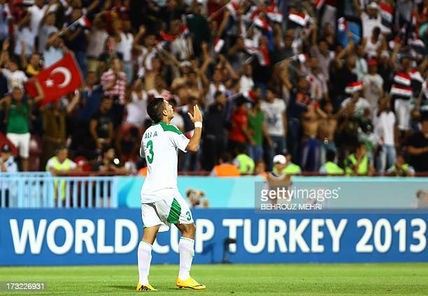 Iraq's Ali Adnan prays after scoring a goal against Uruguay during a semi final football match at the FIFA Under 20 World Cup at Huseyin Avni Aker...