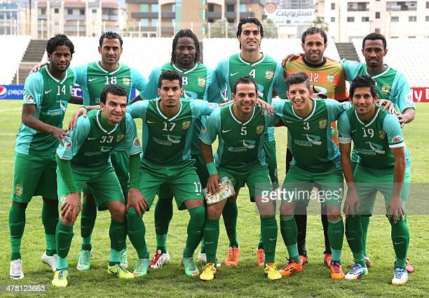 Iraq's alShorta club players pose for a group photograph prior to their match against Syrian AlWahda club during their AFC Cup football match in...