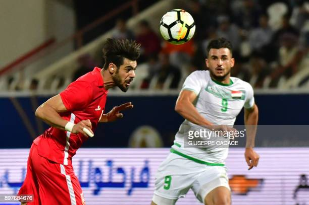 Iraq's Ayman Hussein vies for the ball against Bahrain's Waleed AlHayam during their 2017 Gulf Cup of Nations football match between Iraq and Bahrain...