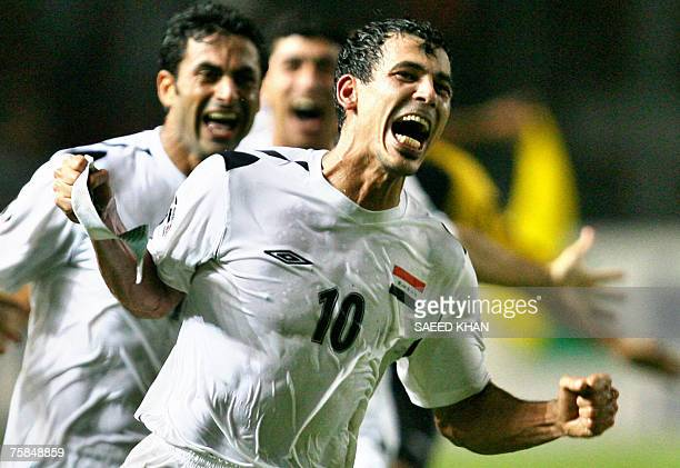 Iraq's captain Younis Mohmoud and teammates celebrate their victory over Saudi Arabia at the end of the final match of the Asian Football Cup 2007 at...