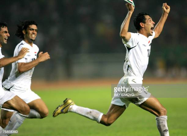 Iraq's captain Younis Mohmoud celebrates with teammates after defeating Saudi Arabia at the end of the final match of the Asian Football Cup 2007 at...