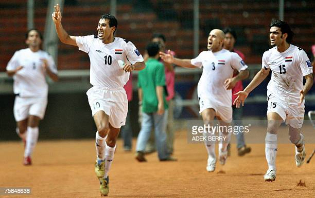 Iraq's captain Younis Mohmoud celebrates with teammates after scoring a goal against Saudi Arabia during the final match of the Asian Football Cup...