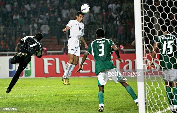 Iraq's captain Younis Mohmoud heads the ball to score his team's first goal against Saudi Arabia during the final match of the Asian Football Cup...