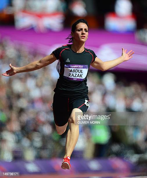Iraq's Dana Abdul Razak competes in the women's 100m heats at the athletics event during the London 2012 Olympic Games on August 3 2012 in London AFP...