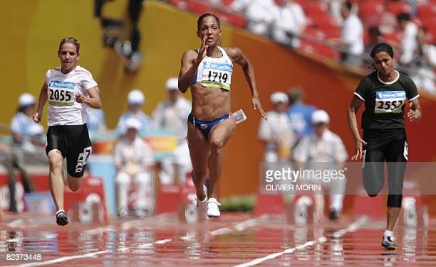 Iraq's Dana Hussein Abdulrazak France's Christine Arron and Pakistan's Sadaf Siddiqi compete during the women's 100m heat 2 at the 'Bird's Nest'...