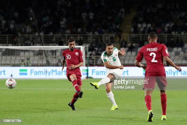 Iraq's defender Ali Adnan attempts a shot during the 2019 AFC Asian Cup Round of 16 football match between Qatar and Iraq at the Al Nahyan Stadium in...