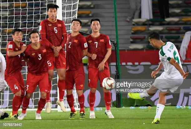 Iraq's defender Ali Adnan kicks a free kick and scores during the 2019 AFC Asian Cup group D football match between Iraq and Vietnam at Zayed Sports...