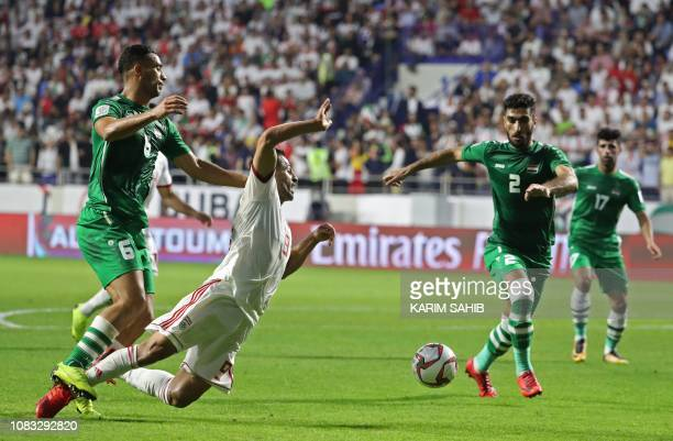 Iraq's defender Ali Adnan tackles Iran's midfielder Omid Ebrahimi during the 2019 AFC Asian Cup group D football match between Iran and Iraq at the...