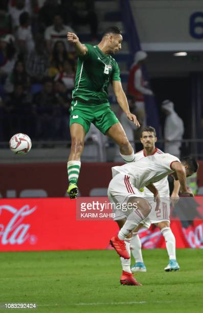 Iraq's defender Ali Adnan vies for the header during the 2019 AFC Asian Cup group D football match between Iran and Iraq at the Maktoum Stadium in...