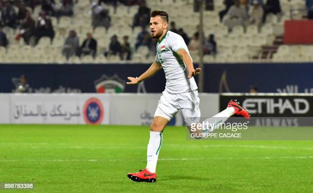 Iraq's defender Ali Faez celebrates after scoring a goal against Qatar during their 2017 Gulf Cup of Nations group match at Al Kuwait Sports Club...