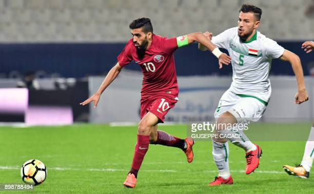 Iraq's defender Ali Faez vies for the ball against Qatar's forward and captain Hassan AlHaidos during their 2017 Gulf Cup of Nations group match at...