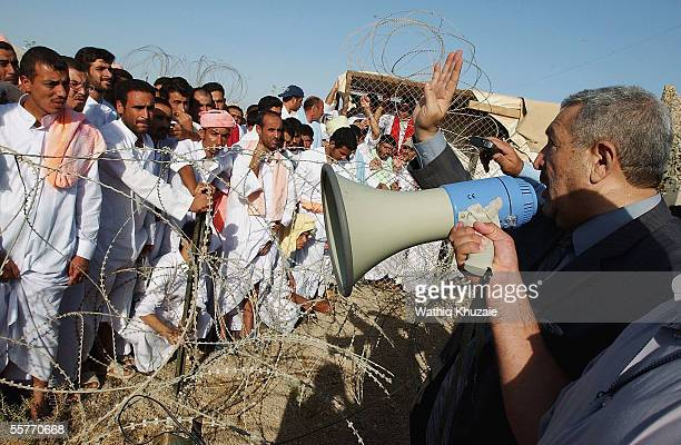 Iraq's Deputy Prime Minister Abed Mutlak alJiburi speaks to Iraqi detainees before their release from Abu Ghraib prison facility on September 26 2005...