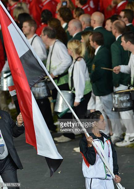 Iraq's flagbearer Dana Abdul Razak leads her delegation during the opening ceremony of the London 2012 Olympic Games on July 27 2012 at the Olympic...