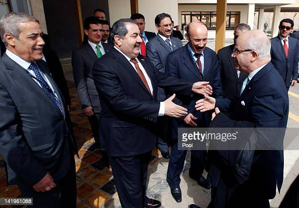 Iraq's Foreign Minister Hoshiyar Zebari welcomes Algeria's Foreign Minister Mourad Medelci before Arab foreign ministers meeting at Baghdad's airport...