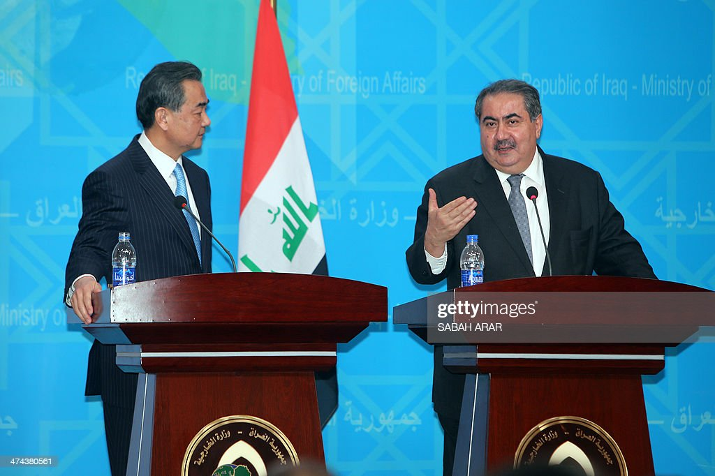 Iraq's Foreign Minister Hoshyar Zebari (R) speaks near Chinese Foreign Minister Wang Yi during a press conference on February 23, 2014 in the capital Baghdad. Wang Yi, who arrived in Iraq in the first such visit since before the 2003 US-led invasion, is expected to meet senior officials to discuss developing bilateral relations and regional and international issues.