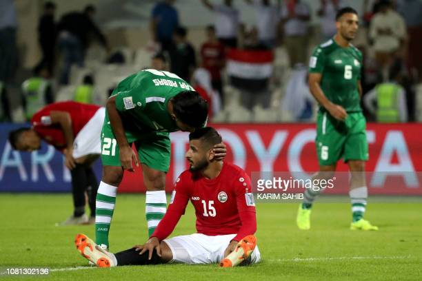 Iraq's forward Alaa Abbas speaks to Yemen's defender Ammar Hamsan during the 2019 AFC Asian Cup group D football match between Yemen and Iraq at...