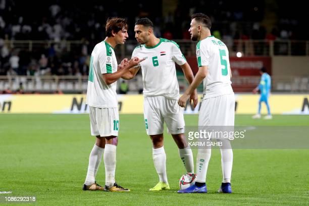 Iraq's forward Mohanad Ali Kadhim Alshammari Iraq's defender Ali Adnan and Iraq's defender Ali Faez speak before taking a freekick during the 2019...