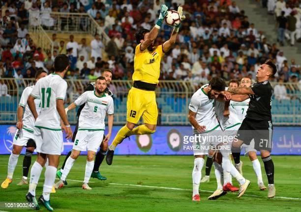 Iraq's goalkeeper Jalal Hassan catches the ball during a friendly football match between Argentina and Iraq at the Faisal bin Fahd Stadium in Riyadh...