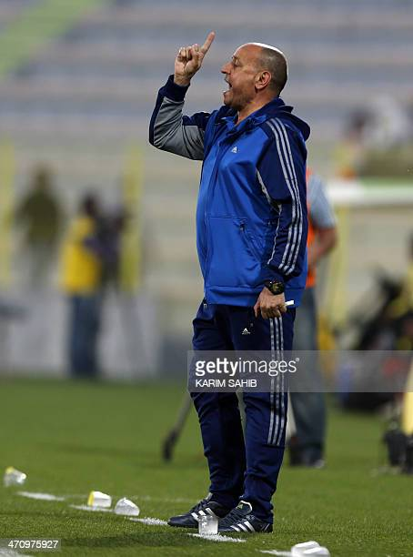 Iraq's head coach Hakeem Shaker gives instructions to his players during their friendly football match against North Korea at AlWassal stadium on...