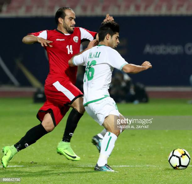 Iraq's Hussein Ali vies for the ball with Yemen's Hamada Ahmad during the 2017 Gulf Cup of Nations football match between Iraq and Yemen at the...