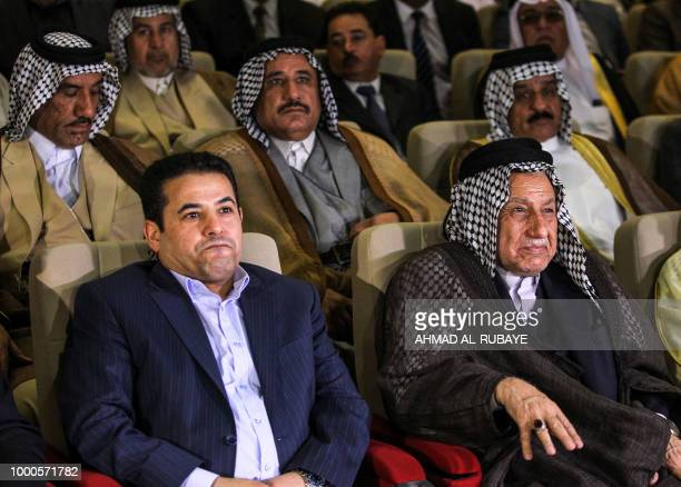Iraq's Interior Minister Qassim alAraji attends a gathering with tribal leaders in the capital Baghdad on July 17 calling upon them to calm down...