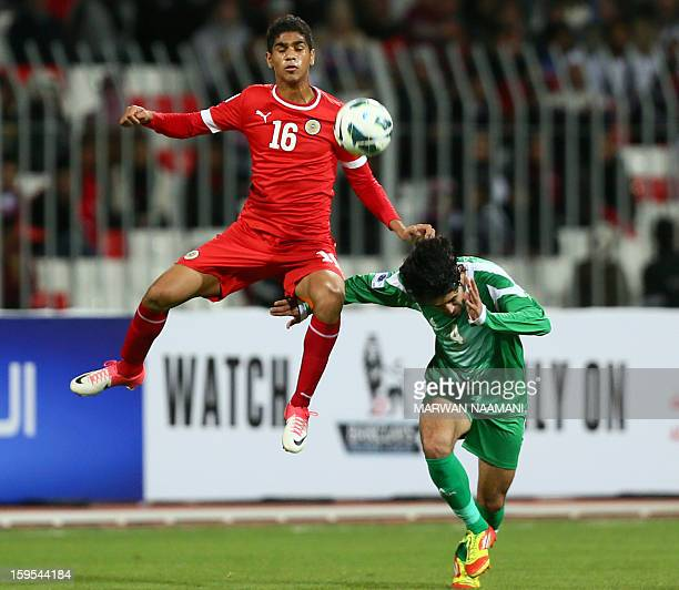 Iraq's Khaldoun Ibrahim AlbuMohammed vies for the ball against Bahrain's Abdulla Yusuf during the two teams semi final match in the in the 21st Gulf...