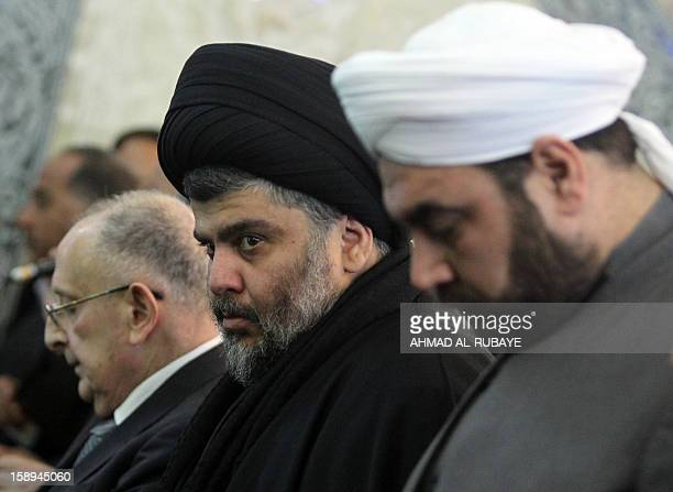 Iraq's maverick Shiite cleric Muqtada alSadr takes part in Friday prayers in which Sunni and Shiite Muslim worshippers took part together in a...
