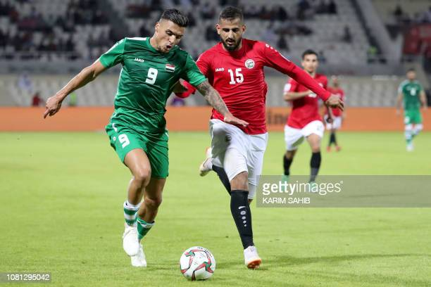 Iraq's midfielder Ahmed Yasin is marked by Yemen's defender Ammar Hamsan during the 2019 AFC Asian Cup group D football match between Yemen and Iraq...