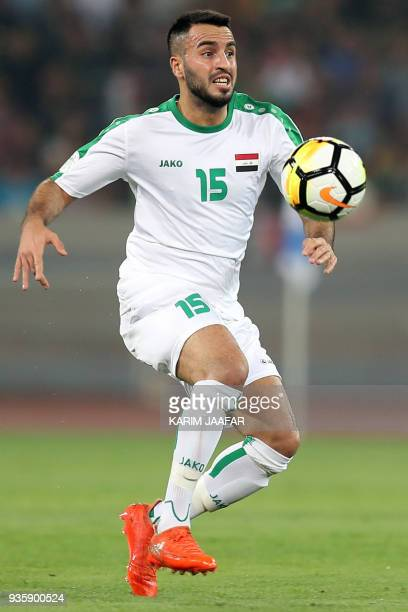 Iraq's midfielder Brwa Nouri receives the ball during the international friendly football match between Iraq and Qatar at the Basra Sports City...
