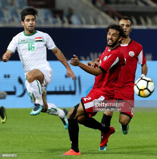 Iraq's midfielder Hussein Ali vies for the ball against Yemen's midfielder Abdulwasea AlMatari during their 2017 Gulf Cup of Nations group match at...