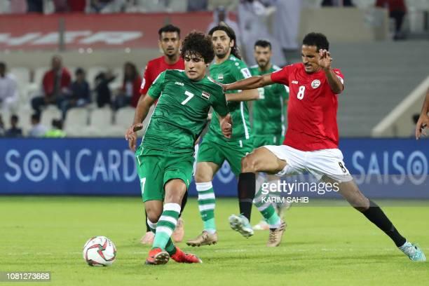 Iraq's midfielder Safaa Hadi AlFuraiji is marked by Yemen's midfielder Wahid Al Khyat during the 2019 AFC Asian Cup group D football match between...