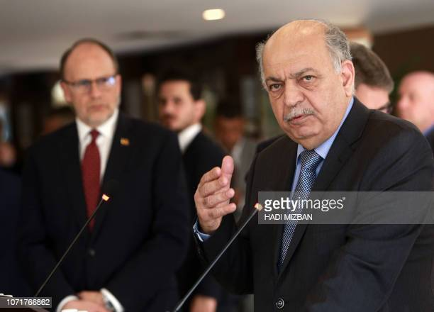 Iraq's Minister of Oil Thamir alGhadhban speaks during a joint press conference with US Energy Secretary in the Iraqi capital Baghdad on December 11...
