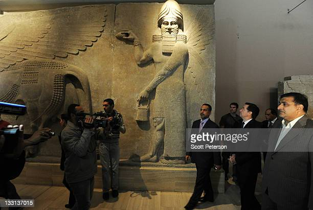 Iraq's Minister of Tourism and Antiquities Liwaa Semeism and French Ambassador to Iraq Denys Gauer open a Frenchsponsored exhibit about the earliest...