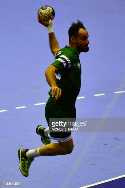 Iraq's Mohanad Adil Talib Al Behadili attempts a shot on goal during the men's handball preliminary Group D match between India and Iraq at the 2018...