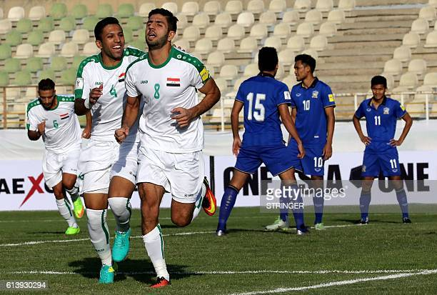 Iraq's Mohannad AbdulRaheem Karrar celebrates with teammates after scoring a goal against Thailand during their 2018 World Cup qualifying football...