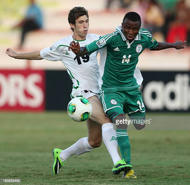 Iraq's Mustafa Mohammed vies with Nigeria's Chidiebere Nwakali during their FIFA U17 World Cup UAE 2013 football match Iraq versus Nigeria on October...