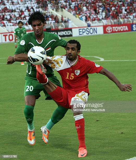 Iraq's Muthana Khalid challenges Oman's Ismail alAjmi during their group B Asian zone qualifying football match for the 2014 World Cup in Muscat on...