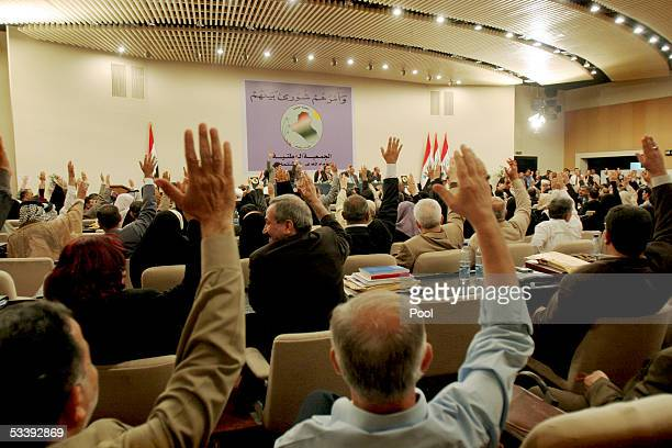 Iraq's National Assembly votes unanimously for a seven day extension for the constitution draft on the eve of the original deadline August 15 2005 in...