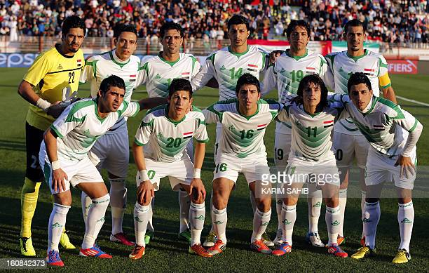 Iraq's national football team players pose for a picture before their 2015 Asian Cup group C qualifying football match against Indonesia in the Gulf...