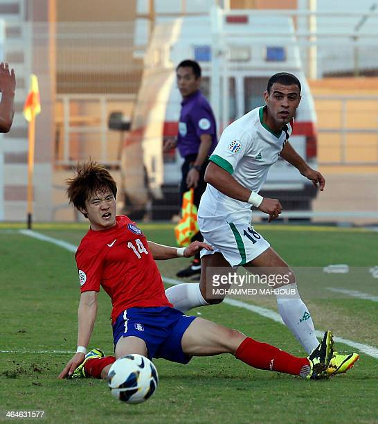 Iraq's player Marwan Hussein vies for the ball with Korea Republic's Kim Younguk during their AFC U22 Championship semi final football match in...