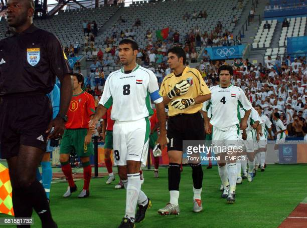 Iraq's players are lead out by captain AbdulWahab Abu Hail