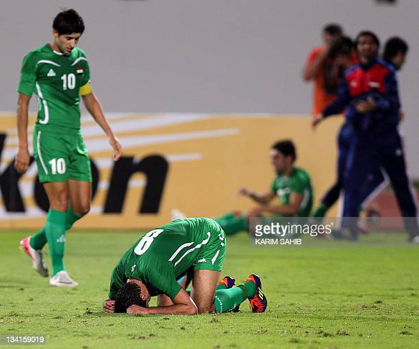 Iraq's players celebrate after wining 20 against the UAE during their third round Asian qualifying football match for the 2012 London Olympics in the...